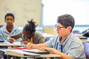 Career Academy South Bend students writing in classroom